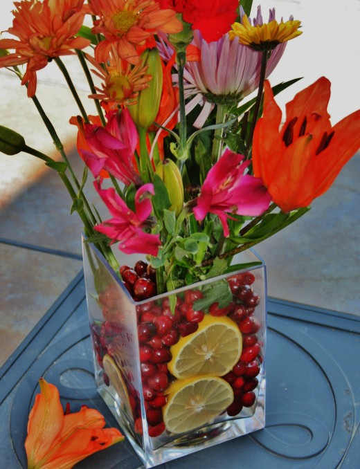Cut up or whole, fruit adds color and flair to clear vases of flowers.