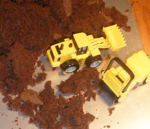 Yes, that's a chocolate cake these construction machines have torn to pieces...