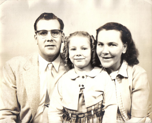 Here are mom, dad, and sis after dad adopted Sandy. I both smile and tear up whenever I see this photo.
