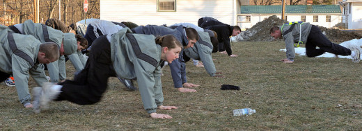 National Guard recruits doing mountain climbers.