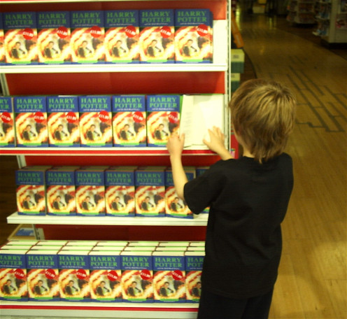 """Knowing your audience is a key consideration. Photo shows boy examining """"Harry Potter and the Half Blood Prince,"""" taken July 15, 2005."""