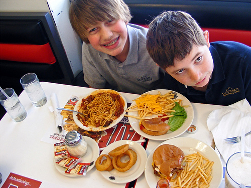 Steak n Shake hamburger, fries, onion rings, and chili spaghetti