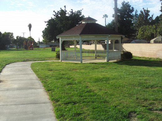 Another view of the gazebo with a palm tree in the distance.