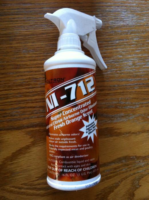 NI-712 Airborne Odor Eliminator Fresh Orange with a sprayer attached