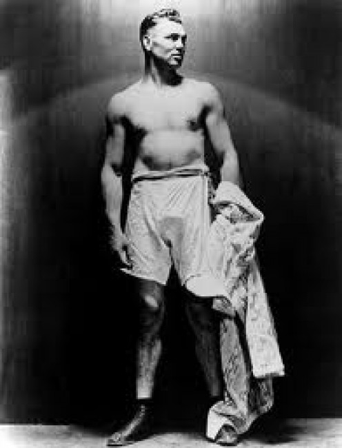 The Ring: Celebrating 80 Years With A picture of Jack Dempsey. He is the former heavyweight champion of the world.