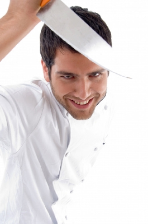 Male Chef Holding Knife