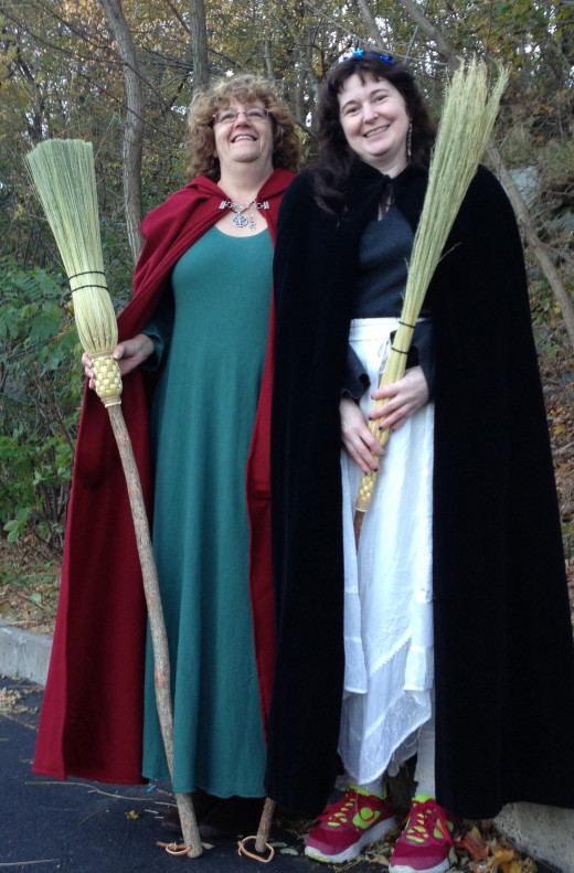 Lady friends J. and K. are ready to take flight with their brooms from New England Magic. Used with permission.