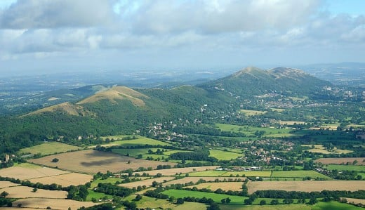 The Malvern Hills located in the English counties of Worcestershire and Herefordshire. The hills have been designated by the Countryside Agency as an Area of Outstanding Natural Beauty. The highest point is the Worcestershire Beacon at 425 metres (1,