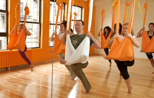 Flying Pigeon Pose in Aerial Yoga Class