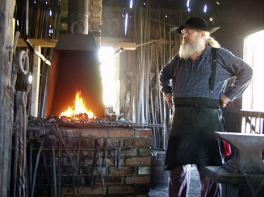 Blacksmith, always warm inside this building as he keeps the fire going.