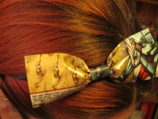 Comic book bow on a headband.