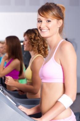 Group Of Women Running On Treadmill
