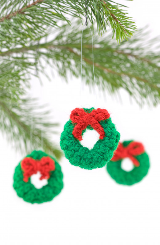 Crocheted Wreath Christmas Decorations by South12th  Crocheted Wreath Christmas Tree Decorations Hanging isolated on White