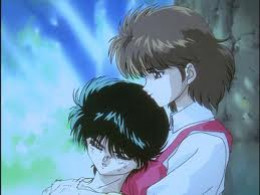 Keiko protecting Yusuke after receiving his master's power.