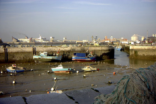 Calais harbor at low tide. Note the ferry in the background to the left