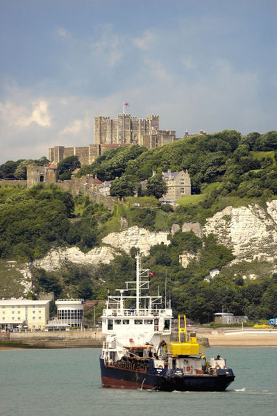 Dover Castle from the sea. The vessel in the foreground is the harbour dredger David Church.