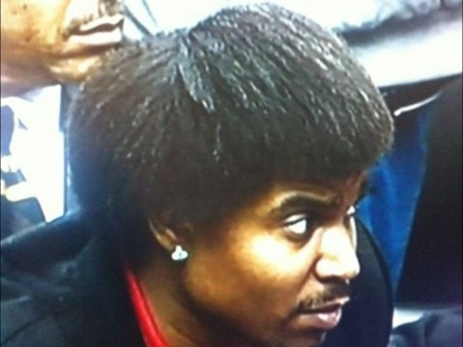 Andrew Bynum sports a new do from the bench of a 76ers game.