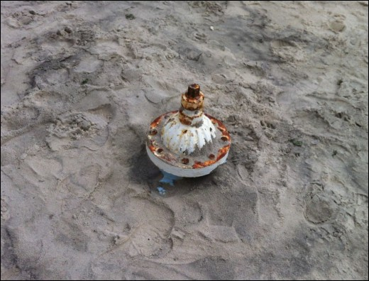 Fire hydrant burried in sand in Long Beach