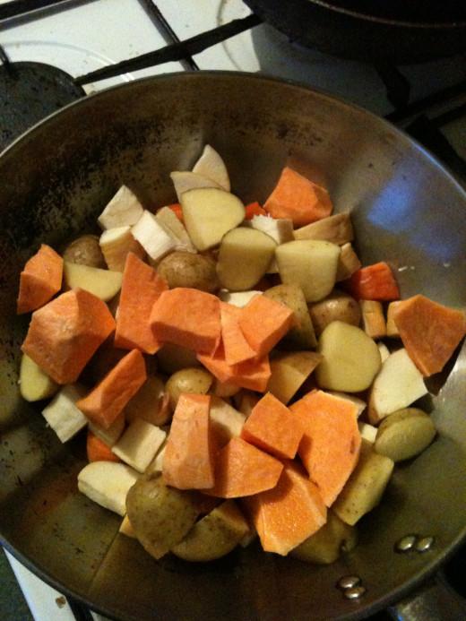 Chopped veggies in large pan.
