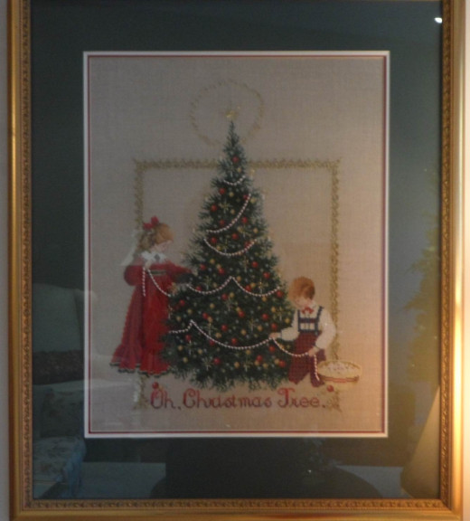 """Oh Christmas Tree""   Crossstitched and framed by my mother."