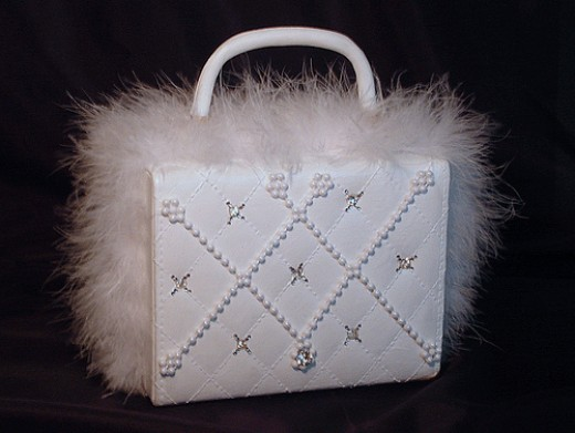 suitcase style purse hand painted and decorated with fur trim, pearls and rhinestones.