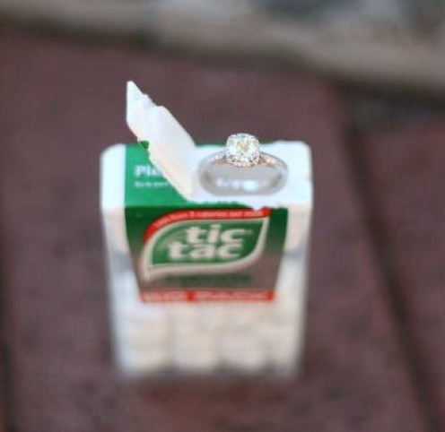 Propose by placing the bling in a tic tac container.