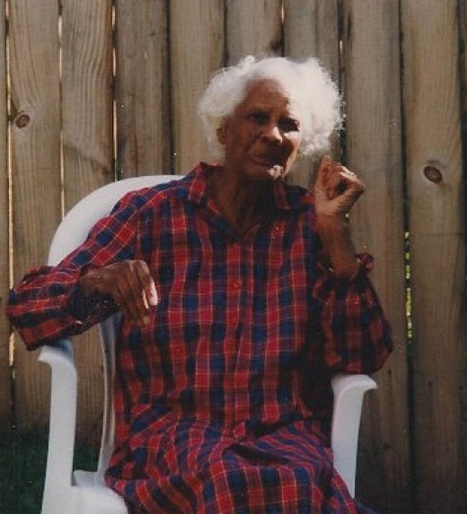 She only looks scary; this is the boys' great-grandmother.