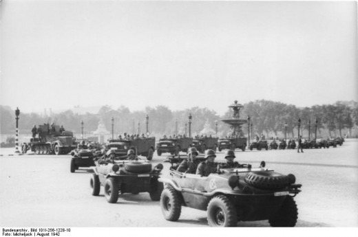 August 1942. German military convoy on Place de la Concorde, featuring Porsche engineered Schwimmwagen vehicles in the foreground
