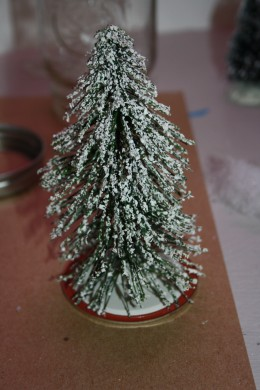 Glue the large tree to the flat of the jar lid.