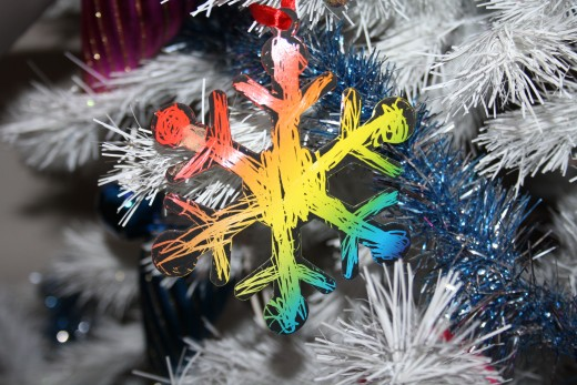 A snowflake made with scratch paper.