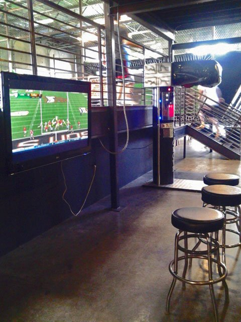 Flat Screen TV and Punching Bag Game at Absolute Air Park