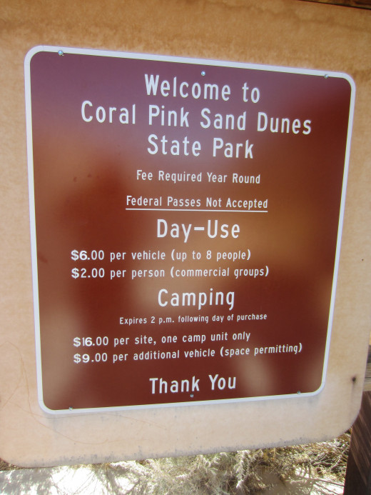 Fee sign at entrance to Utah's Coral Pink Sand Dunes State Park