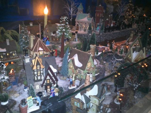 Glittering miniature town displays dazzle inside the stores.
