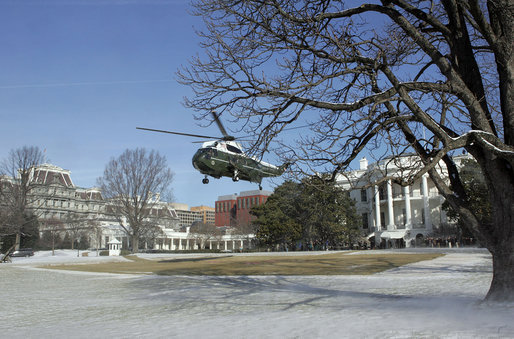 This is a United States Government photograph of the White House and Marine One in winter.