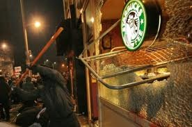 The guy in the picture smashing a Starbucks.