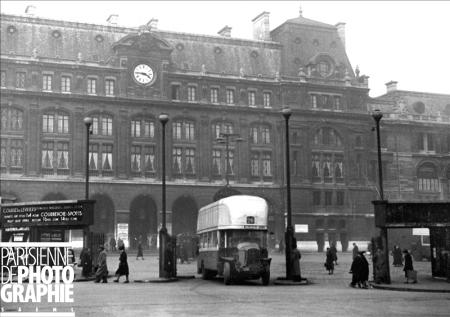 February - Modified gas powered city bus in front of Saint-Lazare train station. Copyright Roger-Viollet