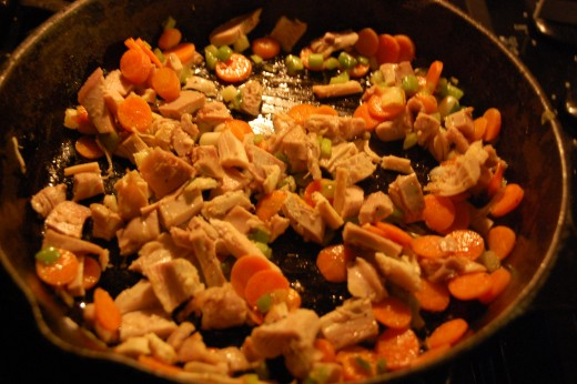 Then place the turkey in the skillet with the vegetables