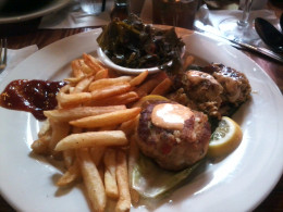 Eastern Coast Crab Cakes with sides Old Bay French Fries and Smoked Turkey Collards