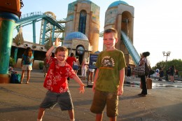 The author's two thrill-seeking sons pose in front of Journey to Atlantis.