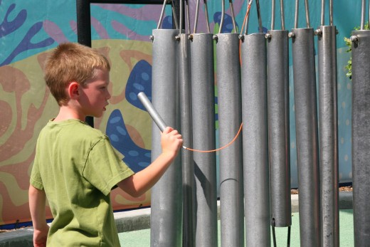 Playing chimes at the Bay of Play.