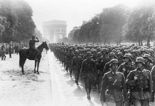 June 14, 1940. German military forces parade down from the Arc de Triomphe in Paris, shortly after the invasion of France