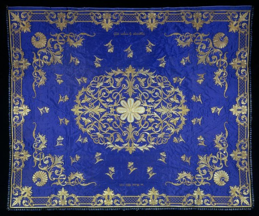 This Marriage Canopy, created in 1867 to 1868, is currently located in the Jewish Museum in New York City. It is in the public domain in the European Union and non-EU countries with a copyright term of life of the author plus 70 years or less.