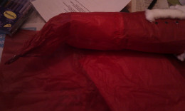 Completely cover in red crepe paper