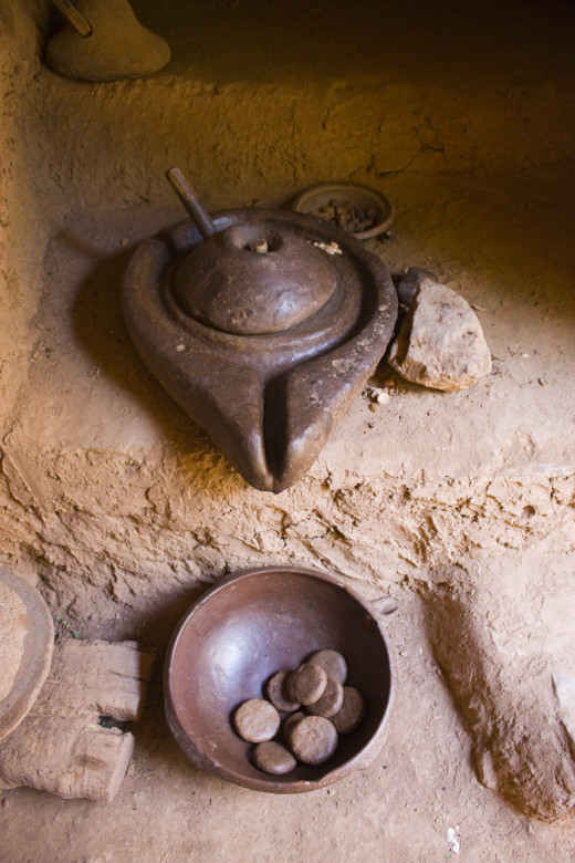 Argan oil grinder crushes the fruits and pours the raw oil.