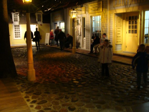 Cobblestone street with the store fronts.