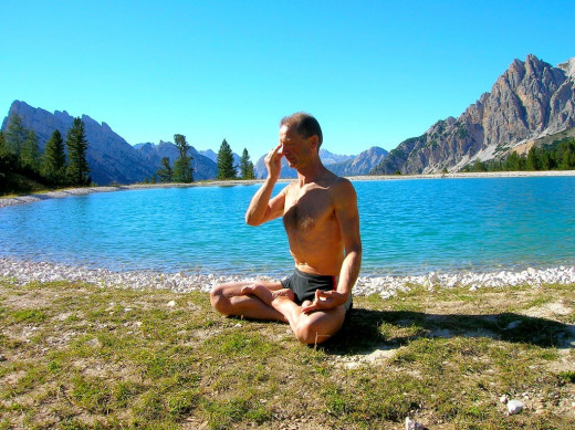 Practicing the Kapalabhati pranayama or skull brightener yoga breathing exercise.