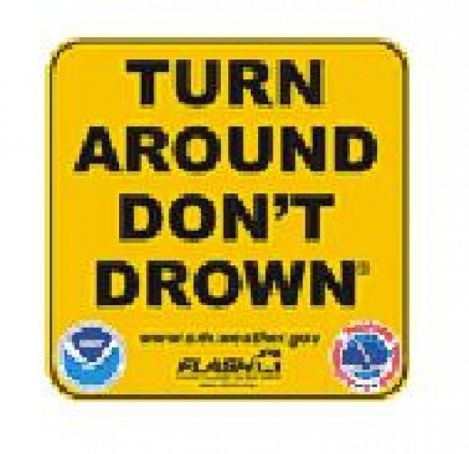 These TADD signs are a clear indicator of flooded roadways, warning drivers to stear clear and take another route.