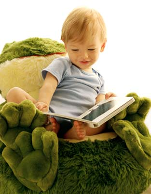 My son has always enjoyed looking at books even when he was one. His favorite place to read was his green frog chair