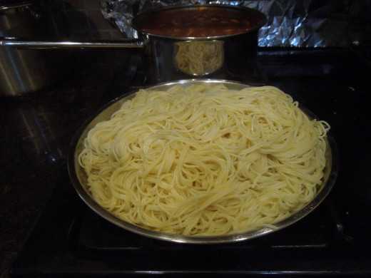 Pasta - boiled and mixed with olive oil which will enhance the taste of the pasta as well as keeping the paste moist.