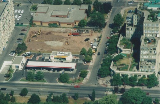 Parking garage site with construction beginning, July 2002.